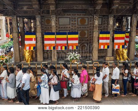 Kandy, Sri Lanka - November 8, 2017: Sri Lankan Buddhists queueing  up at the Temple of Sacred Tooth  Relic for paying respect to the Buddha tooth relic.
