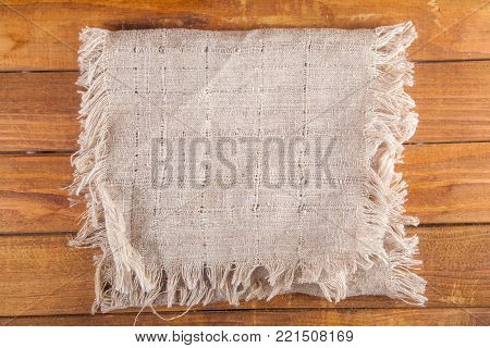 Blank sackcloth on wooden table. Top view