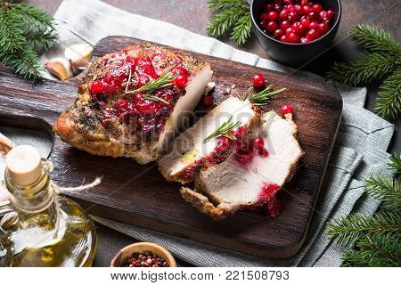 Baked pork meat with cranberry sauce. Christmas Winter meat recipe.