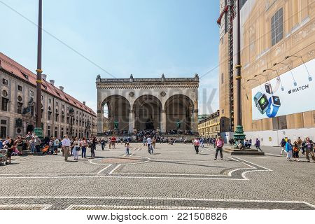 Munich, Germany - May 29, 2016: People walking in front of Field marshall's hall (Feldherrnhalle), a monumental loggia on the Odeonsplatz in Munich, Bavaria, Germany.