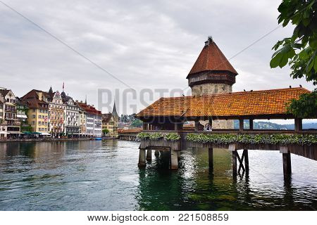 Lucerne, Switzerland - June 14, 2017: Historic city center of Lucerne with Famous Chapel bridge at dawn