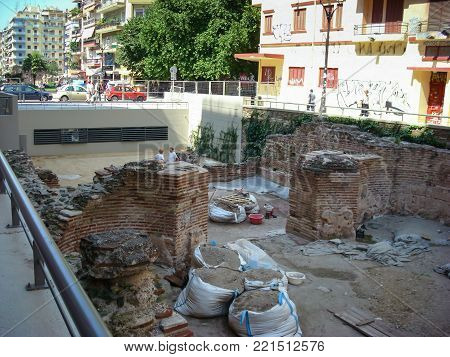 Thessaloniki, Greece - June 07 2014 : archaeological digging site monument in center of Thessaloniki City, Greece.