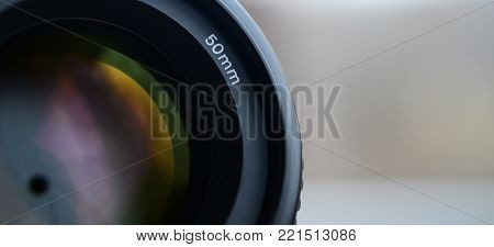 Fragment of a portrait lens for a modern SLR camera. A photograph of a wide-aperture lens with a focal length of 50mm