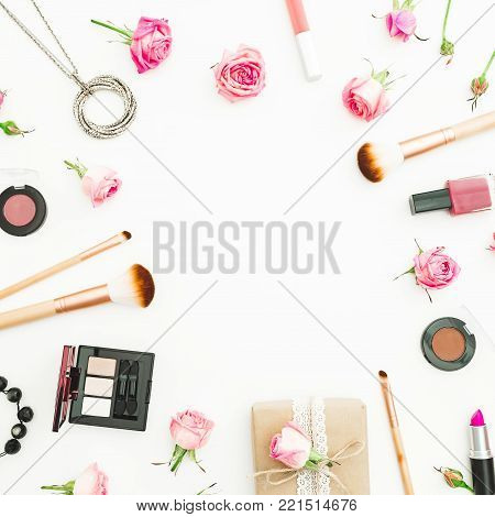 Feminine desk with gift box, pink roses, cosmetics, diary on white background. Top view. Flat lay. Valentines day frame composition.