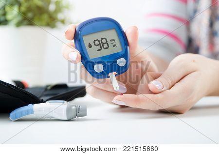 Diabetes Doing Blood Glucose Measurement.