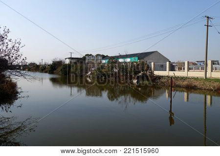 SHANGHAI, CHINA-JAN 08, 2018: A generic house of Chinese rural village located next to the river in Shanghai, China