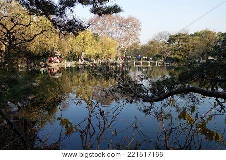 HANGZHOU, CHINA-JAN 08, 2018: Unidentified people walk around the beautiful scenic area in West lakein Hangzhou, China.