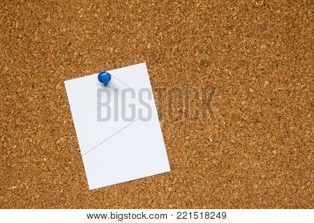 Blank white paper pin on cork board background for remind, to do list or news bulletin