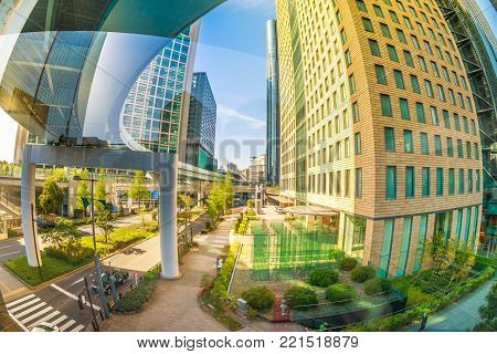 Tokyo, Japan - April 20, 2017: fisheye view of elevated track of Yurikamome railway system and aerial view of Shiodome area in Shimbashi Financial District, Minato Ward. Tokyo urban cityscape.