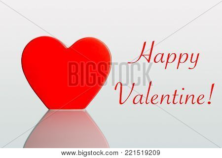 Valentine hearts on a plain pastel background as greeting card and copyspace