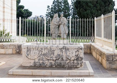 Nazareth, Israel, December 23, 2017 : The sarcophagus and the memorable bas-relief in the courtyard of the Basilica of the Annunciation in the old city of Nazareth in Israel