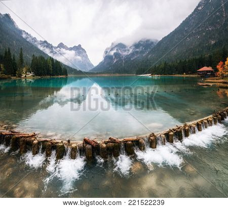 Panoramic view of Dobbiaco lake or Toblacher See in Dolomites, Northern Italy