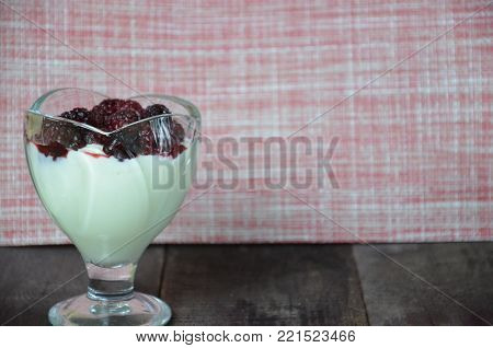 Various dessert breakfast pudding, rice porridge in glass decorated by fresh blackberries, pudding, ice cream, yogurt with blackberries. Beautiful, delicious, low-calorie dessert Breakfast, snack