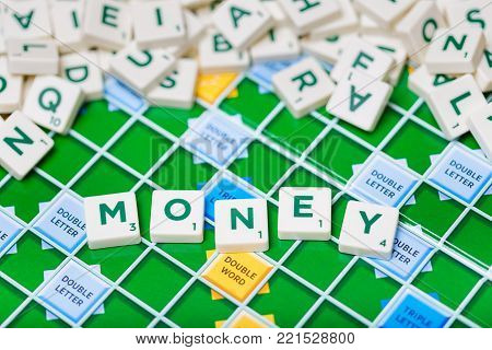 London, England, November 16, 2017 - Scrabble letters spelling the word money