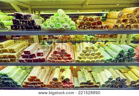 Traditional Turkish dessert - rahat lokum also known as Turkish delight in the showcase of the confectionery store.