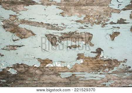 detailed texture of ancient wooden board with paint remains