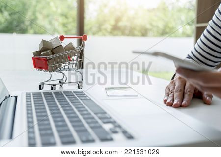 Happy Woman using smart phone and credit card register payments online shopping and customer service network connection market, using technology on laptop, Internet Online shopping or banking concept.