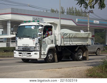 CHIANG MAI, THAILAND -JANUARY 7 2018:  Private Isuzu Dump Truck. On road no.1001 8 km from Chiangmai Business Area.