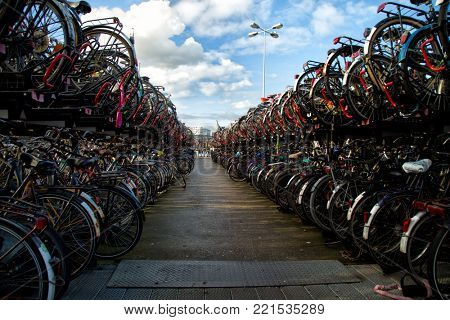 Busy bicycles parking in Amsterdam during a beautiful day
