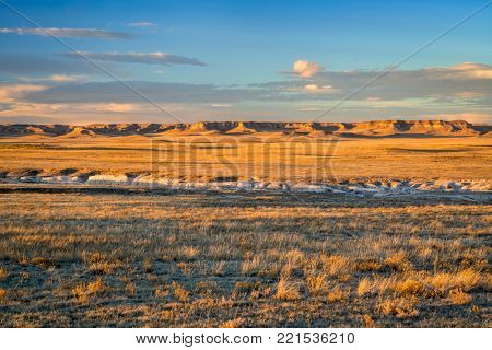 Sunset light over Pawnee National Grassland in northern Colorado, typical winter or fall scenery with a dry grass