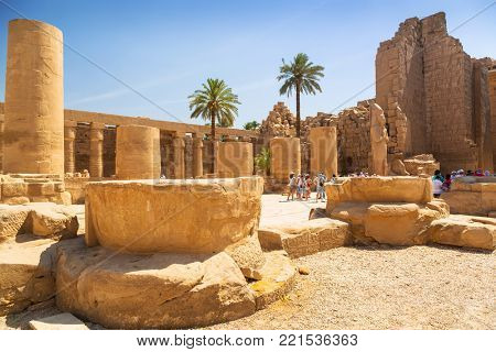 LUXOR, EGYPT - APR 10, 2013: Unidentified tourists at the Karnak temple of Luxor, Egypt. This was the largest temple complex of Amun-Re God in ancient Thebes town.