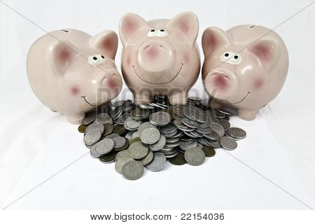 pink piggy bank feasting on hip of coins