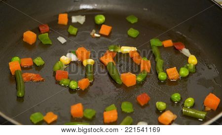 Chopped Vegetables In The Pan Are Collected In The Word Food. Stir Fried Vegetables In The Pan. Vege