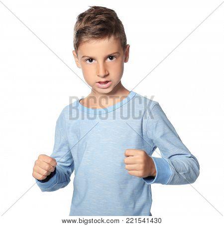 Aggressive little boy on white background
