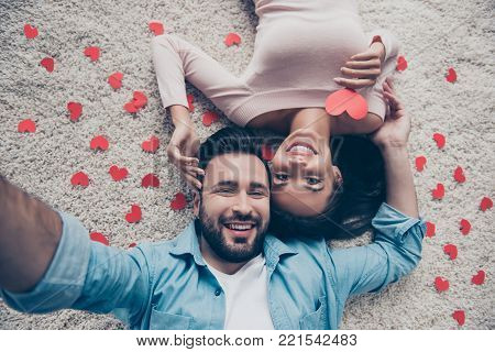 Above Top View Close Up Photo Of Excited Joyful Cheerful Tender Gentle Lying On White Beige Carpet P