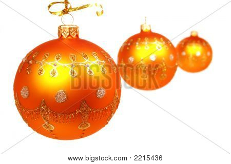 Three Celebratory Spheres Of Yellow Color On White