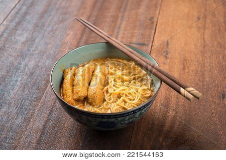 Hot and spicy Malaysian Curry Noodle or laksa mee, serve with chopsticks. Malaysia cuisine.