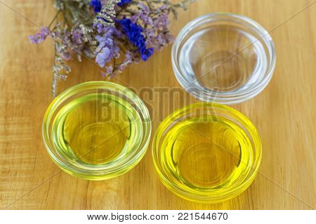 Bowl of different organic oil - cold pressed Coconut oil, Jojoba Oil, Caster oil to make homemade skin beauty product