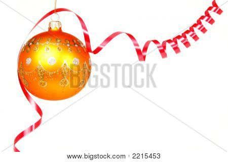 Celebratory Glass Sphere Of Yellow Color And Red Tinsel