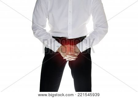 Man is suffering and holding his genitals isolated on white background with clipping path