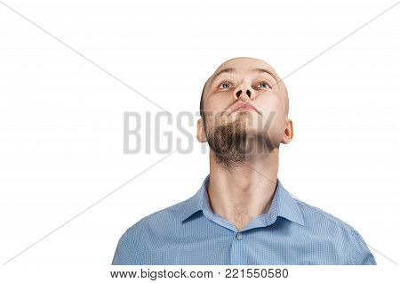 Man in a blue shirt on a white background. Split personality.