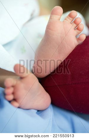 A close-up of tiny baby feet happy family concept. Beautiful conceptual image of Maternity