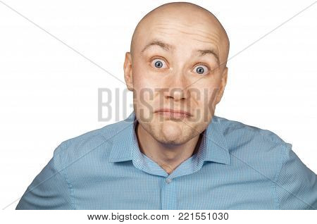 Bald man in blue shirt on a white background in frustration, sad look, isolated.