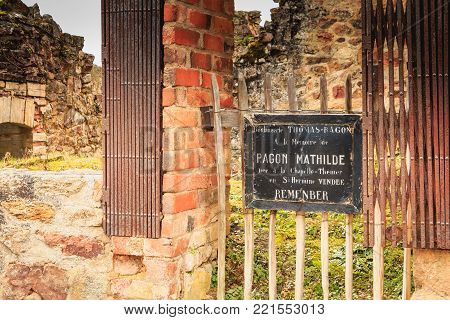ORADOUR SUR GLANE, FRANCE - December 03, 2017 : commemorative tag on the remains in ruins of the THOMAS-RAGON bakery where it is written - In memory of PAGON MATHILDE born in La Chapelle-Thémer in Saint Hermine VENDEE - REMEMBER