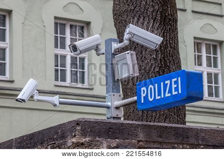 CCTV cameras on display next to a police station (with a police sign in German: Polizei) in the Bavarian city of Munich.