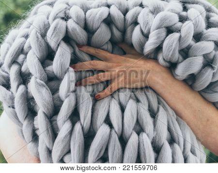 Merino wool handmade knitted large blanket. Close-up of knitted blanket, merino wool background