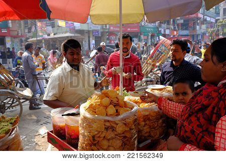 Dhaka, Bangladesh 2018Unidentified market vendor selling food in a local restaurant located at Maibagh at dhaka in bangladesh taken on 10th January 2018. Street foods in India are reasonably priced and easily available.