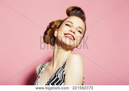 Girl in stylish vintage dress on pink. Beauty and fashion, teacher. Woman with retro hair and fashionable makeup in glasses, pinup. pinup, youth and look. secretary, hairdresser and cosmetics.