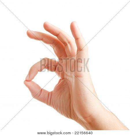 Man's hand showing sign ok