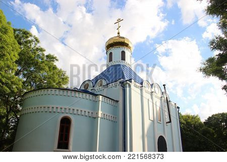Golden domes against the sky as a symbol of Orthodox Christianity. Christian orthodox Church in Gorky Park. Russia, Krasnodar region, Eysk 09 june 2017