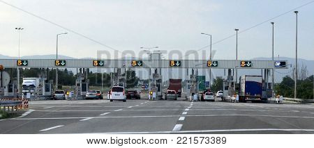 Road signs toll booth on sunny summer day