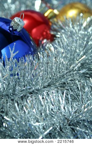 Three Christmas Sparkling Spheres On A Tinsel