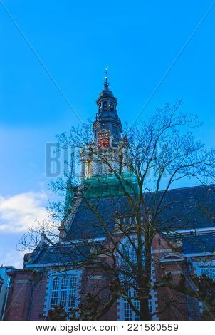 Old Church or Oude Kerk - the oldest building and oldest parish church, founded in 1213 at Amsterdam, Netherlands. It stands in De Wallen, now Amsterdam's main red-light district.