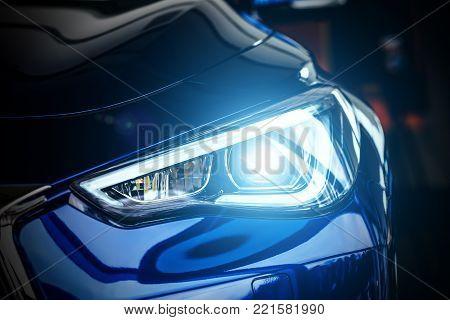 Macro view of modern blue car xenon lamp headlight