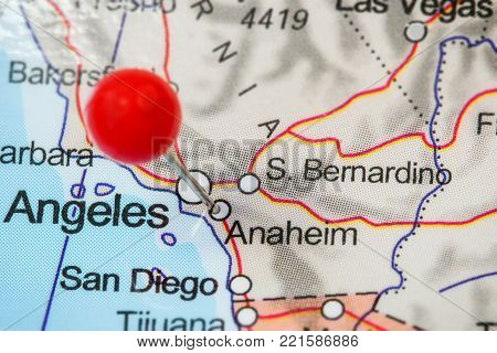 Close-up of a red pushpin in a map of Anaheim, USA.