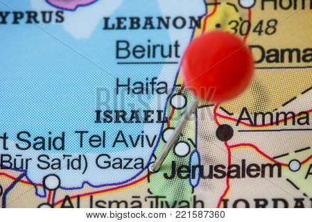 Close-up of a red pushpin in a map of Gaza, Palestine.